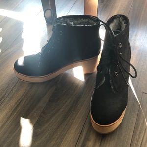 Ariana Bohling platform fur boots